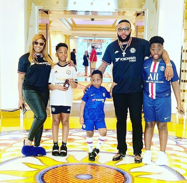 Adorable photo of E-Money, his wife and their children rocking football Jerseys