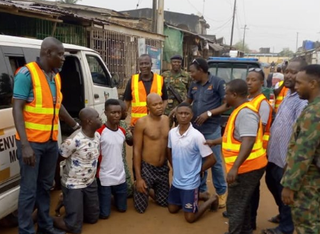 Parents of children caught on camera throwing refuse in drainage channel arrested in Lagos (photos/Video)