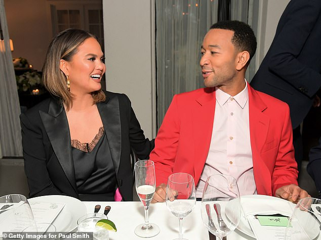 John Legend and Chrissy Teigen endorse Elizabeth Warren for presidency and insist there 'needs to be jail time' for Trump and his whole family