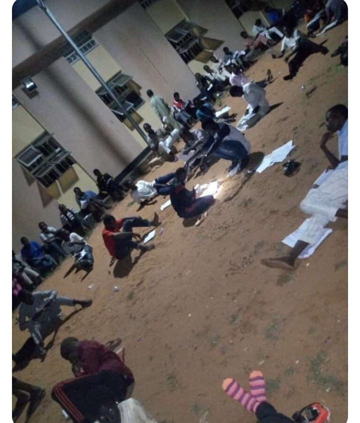 Usman Danfodio University students seen reading under the moonlight due to lack of power supply