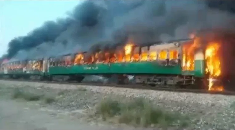 At least 65 dead in Pakistan after a packed passenger train blew up and burst into flames