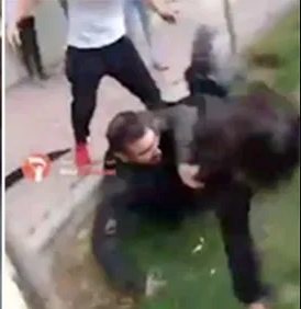 Girl thrown to floor by Iranian police for not wearing a hijab (video)