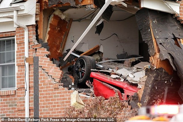 22-year-old Porsche driver and his passenger are killed after car flew off the road and crashed into the second story of a building