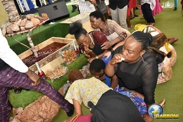 Pastor feeds his church members millipede and beer (photos)