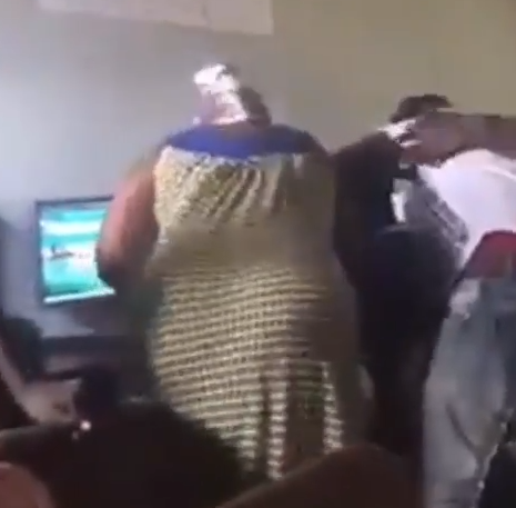 Nigerian mum spotted beating her son at a sports betting shop (video)