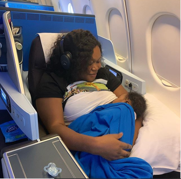 Actress Ruth Kadiri Ezerika breastfeeds her daughter Reign as they travel to Dubai (Photo)
