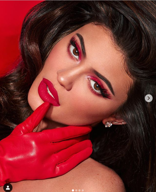 Kylie Jenner shows off her curves in skintight red dress amid selling majority shares in her beauty company (photos)
