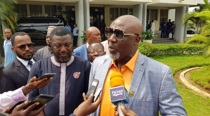 Dino Melaye arrives INEC office with 21 video clips, demand cancellation