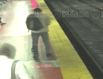 Man falls onto train tracks while looking at his phone (video)