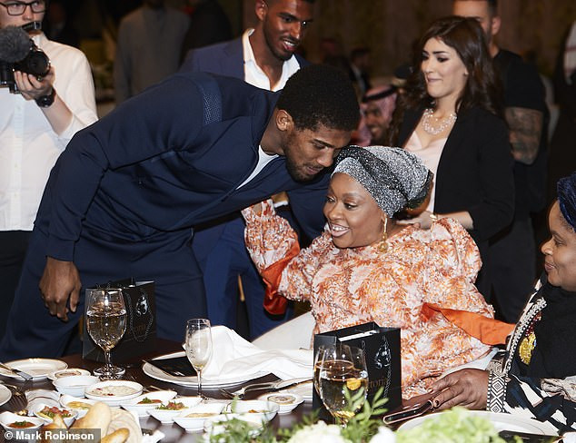 Anthony Joshua pictured with his mom Yeta Odusanya at pre-fight gala dinner ahead of Andy Ruiz Jr rematch (Photos)