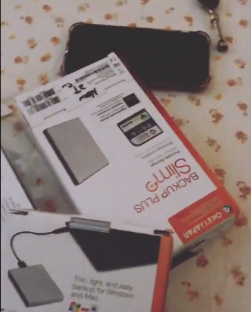 Woman buys brand-new sealed hard drives in Lagos but gets home to find stones inside (video)