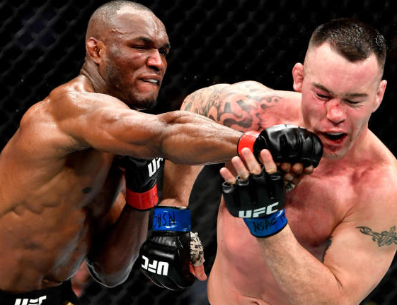 Nigeria-born, Texas-raised Usman Kamaru  beats Colby Covington to win his 11th straight UFC fight and retain the Welterweight title (photos)