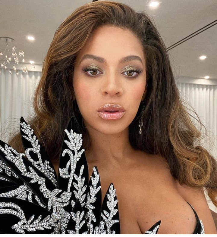 Beyonce oozes glamour in a black off-the-shoulder dress with crotch-high slit for Diddy