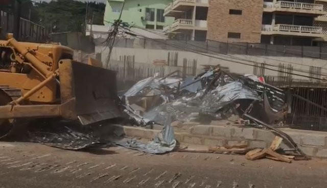 Roads Minister orders arrest of foreign contractors who destroyed a road to construct a 22-storey building (video)