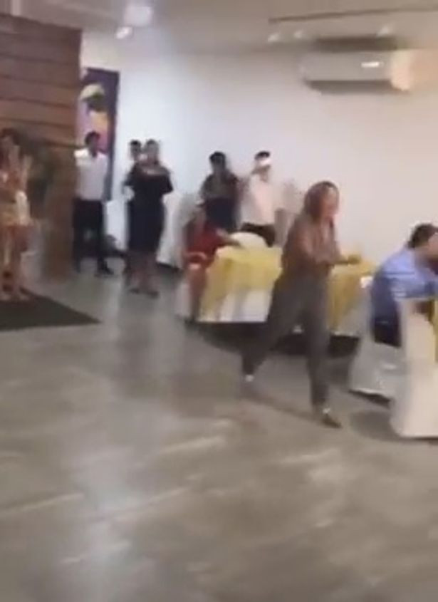 Wedding dissolves into chaos as woman crashes the event to tell groom
