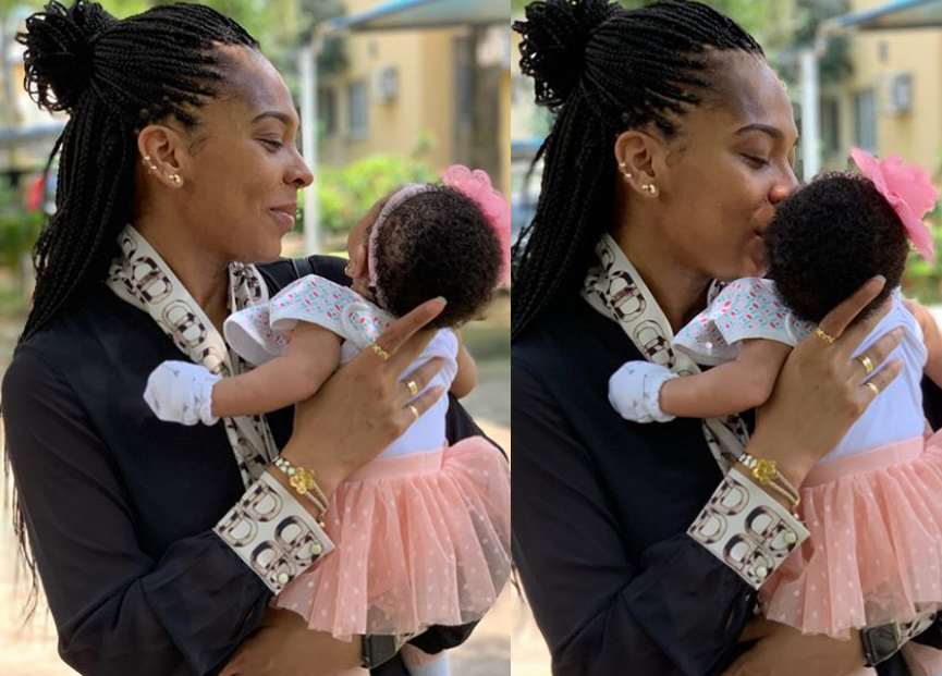 Tboss shares adorable photos with her baby daughter as she writes on her