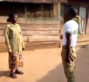 Corps member honors his poor mother who saw him through school by doing a parade and saluting her as he returns home from camp (video)