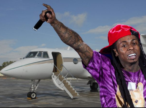 Federal agents on a tip off search Lil Wayne's private jet in Miami for drugs and guns