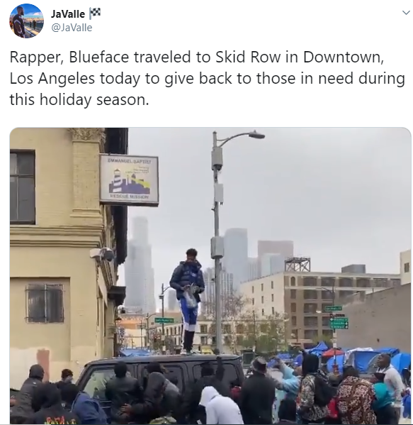 Rapper Blueface criticized for throwing money in the air to people in his community as people fight to pick some (video)