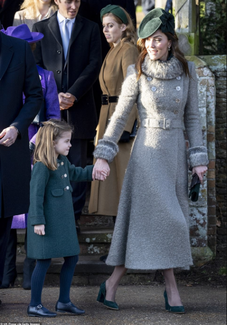 Princess Charlotte hugs woman in wheelchair as she and brother Prince George attend Christmas Day church service for first time