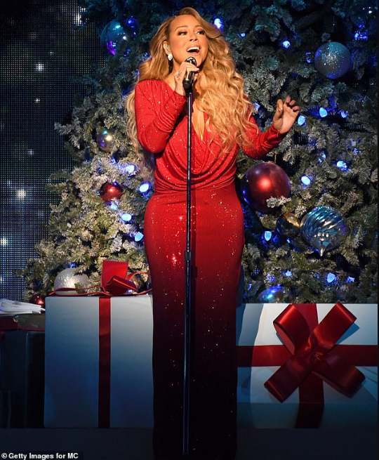 Mariah Carey becomes first artist in history to have a number one song in four different decades