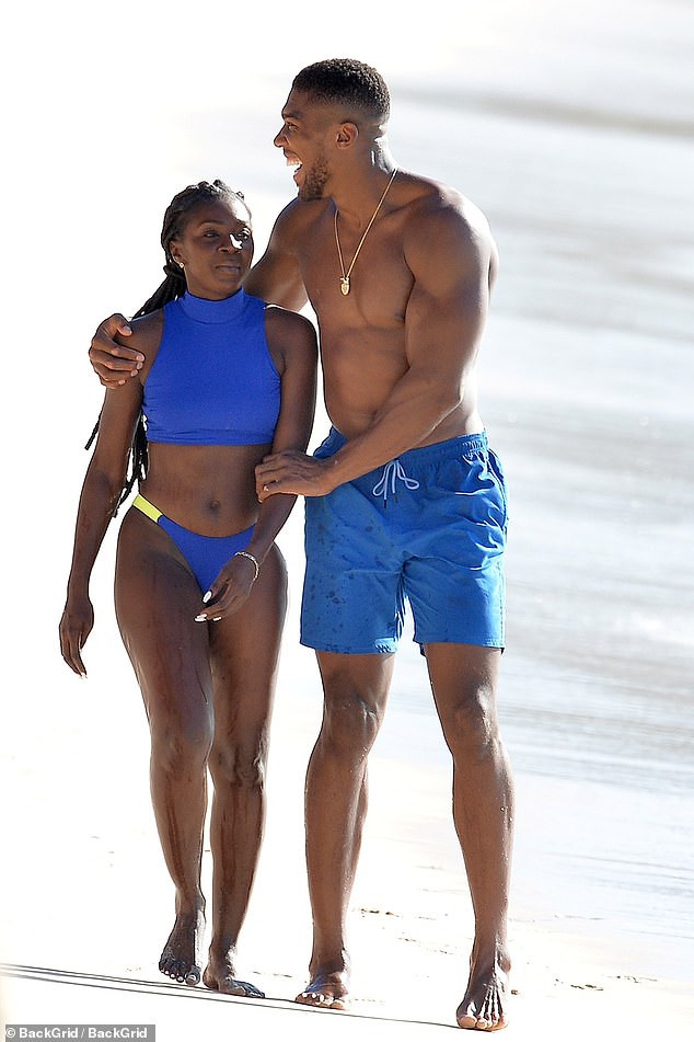 Shirtless Anthony Joshua pictured with a female companion at the beach in Barbados (Photos)