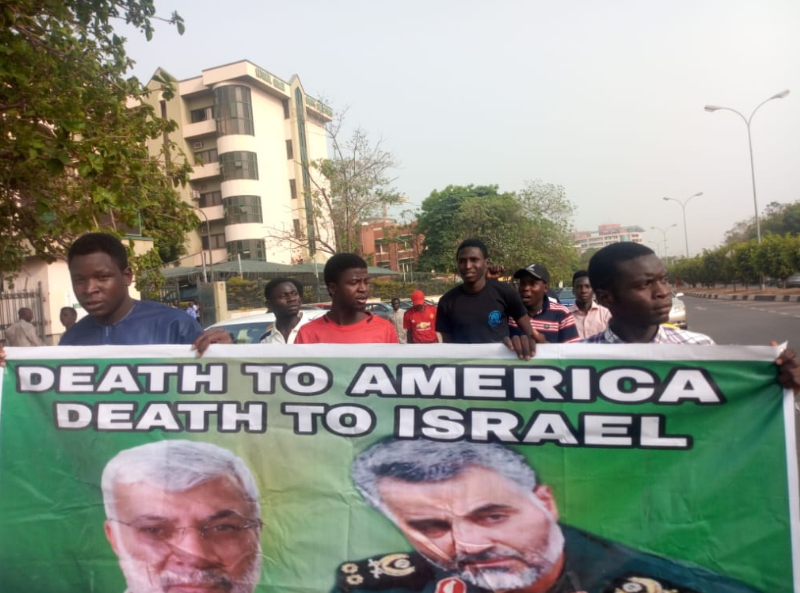 Iranian General?s killing: Shiites protest in Abuja, burn US flag (photos)
