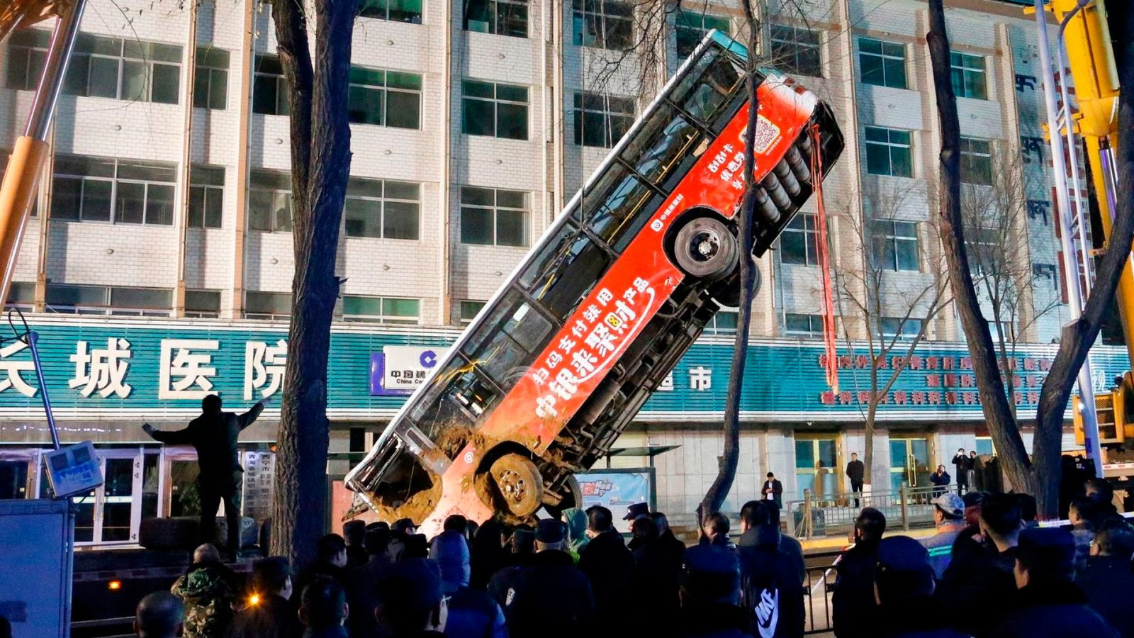 At least six dead as huge sinkhole swallows bus and pedestrians in China (photos)?