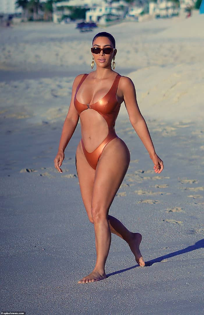Kim Kardashian showcases her curves in skimpy monokini as she hits the beach in Mexico
