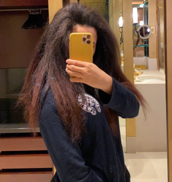 Cardi B shows off her long natural hair
