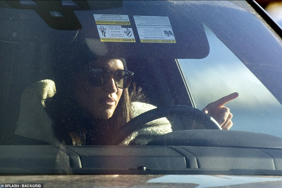 Beaming Meghan Markle drives herself to Canadian airport to pick up her pilates instructor friend (photos)
