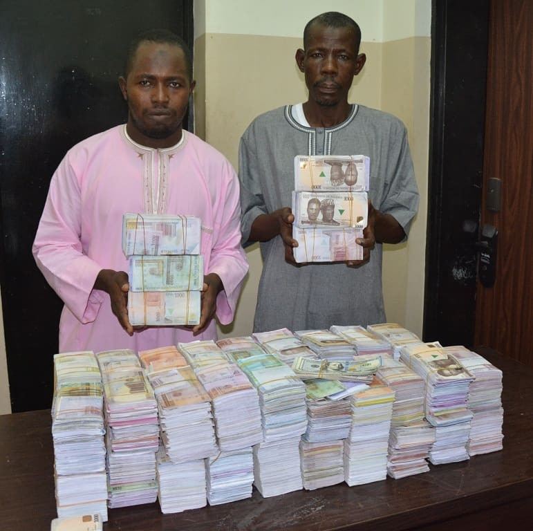 Photos: Two men arrested with N45m fake notes in Abuja