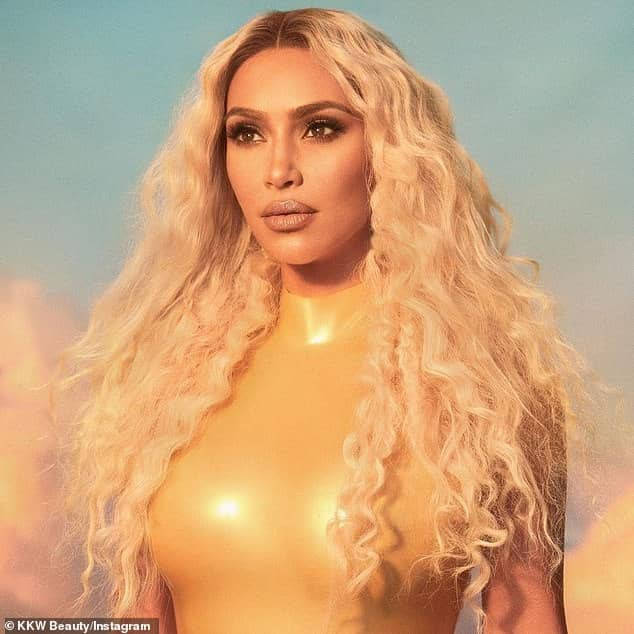 Reality star Kim Kardashian flaunts her curvy body in a stunning gold leotard (Photos)