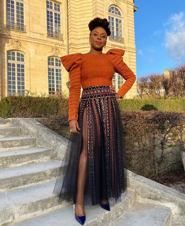 Chimamanda Ngozi Adichie puts her legs on display as she dons a skirt with a crotch-high slit