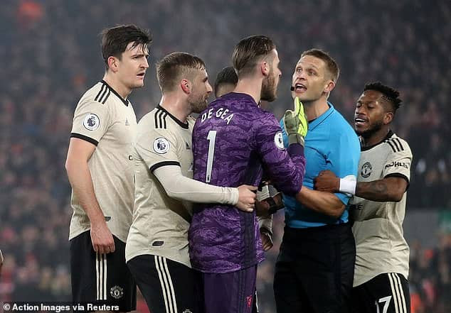 Manchester United hit with FA charge for surrounding referee Craig Pawson during Liverpool clash
