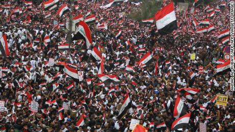 Hundreds of thousands of protesters in Iraq march through streets of Baghdad calling for US troops to leave Iraq (photos)