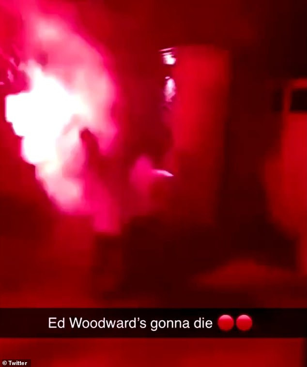 Angry fans launch fireworks and smoke bombs at Manchester United chief Ed Woodward