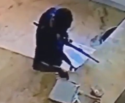 NSCDC official caught on camera stealing from the bag of a salesgirl (video)