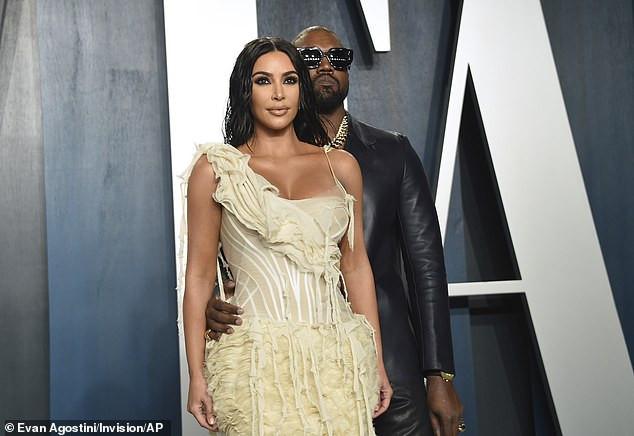 Kim Kardashian locks lips with husband Kanye West at star-studded Vanity Fair Oscars party (Photos)
