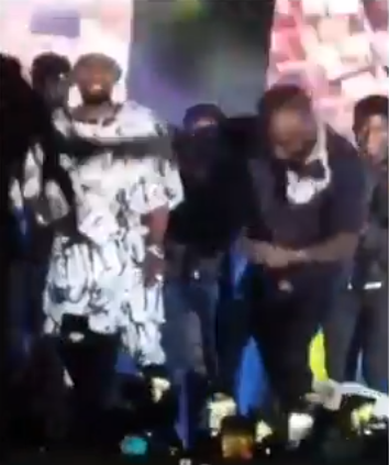 (Watch) Moment Davido ducked a fan who bounced on stage to hug him