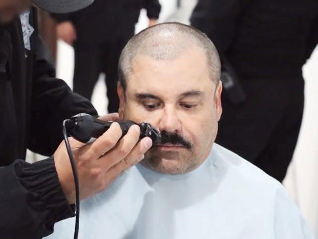 Rare video emerges of Mexican drug lord El Chapo receiving haircut inside high security prison cell