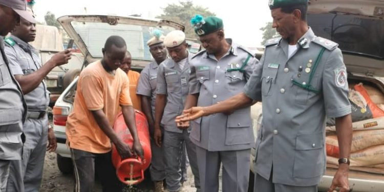 Customs seizes 1,393 bags of rice hidden in gas cylinders