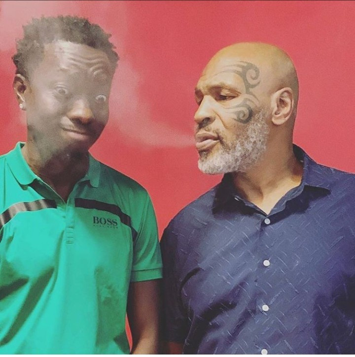 Michael Blackson pictured with Mike Tyson after he jokingly indicated interest in marrying his daughter for $10 million reward