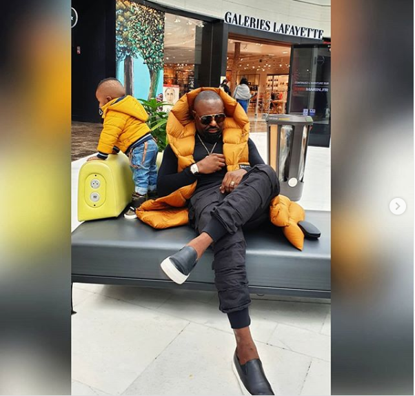 Daddy Duties: Actor Jim Iyke steps out with his son as they enjoy a stroll in Paris (Photos/Videos)