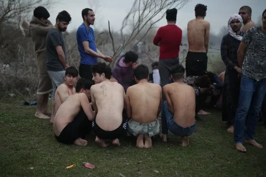 Refugees attempting to enter Greece are stripped to their underwear and forced back to Turkey (photos)