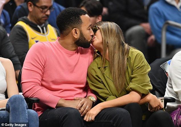 Couple Goals: John legend and wife Chrissy Teigen a share kiss at Basketball game (photos)