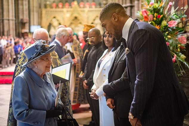 Anthony Joshua towers over the Queen as they chat after the Commonwealth Day service at Westminster Abbey (Photos/Video)