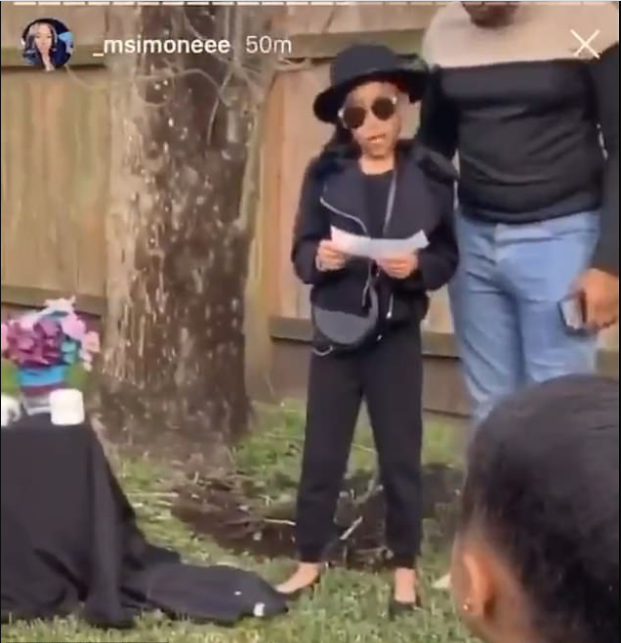 Little girl holds an elaborate funeral for her pet rodent, complete with an obituary, and her family turned up in black for the ceremony (video)
