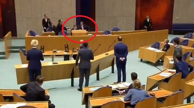 Shocking moment Dutch Health Minister collapses in Parliament due to