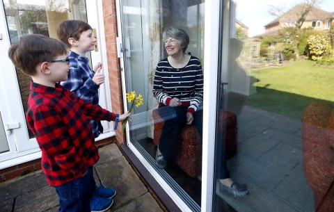 Coronavirus: Two brothers talk to their self isolating grandma through a window on?Mother
